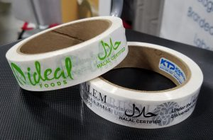 two rolls of tape printed with halal symbols