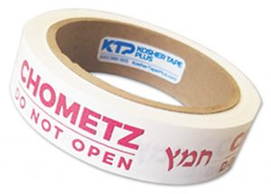 "roll of tape printed with ""Chometz -- do not open"" in red ink"